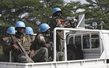 ** FILE ** U.N. forces patrol a street in Abidjan, Ivory Coast, on Thursday, Dec. 23, 2010. (AP Photo/Sunday Alamba)