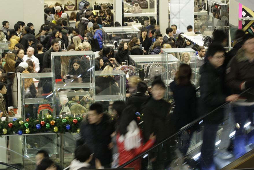 British shoppers get a head start on their American cousins at Selfridges department store in London on the first day of post-Christmas sales on Sunday, Dec. 26, 2010. Retailers are hoping for a Boxing Day bonanza as they slash prices in a bid to entice prospective customers into their stores. (AP Photo/Sang Tan)