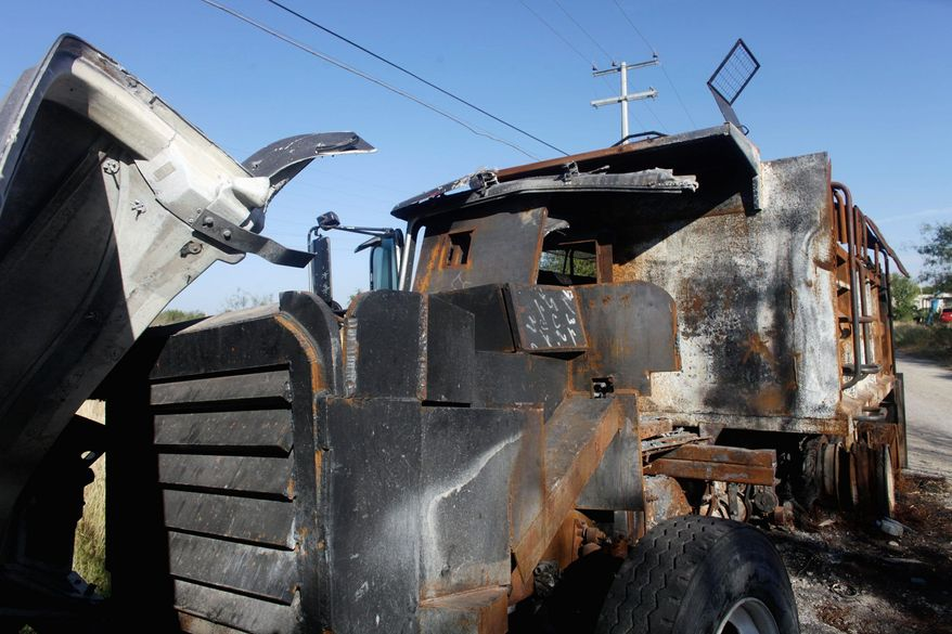 """The Monster,"" a gravel truck the Zetas converted into a steel-clad tank but the Gulf Cartel destroyed, sits outside Ciudad Mier."