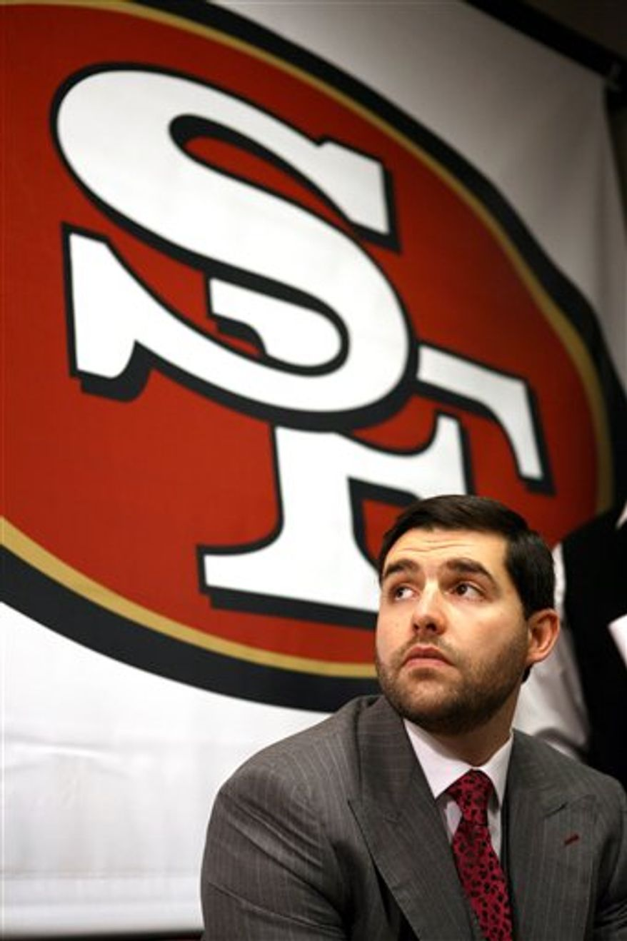 The San Francisco 49ers' CEO and team president Jed York, right, introduced their new interim head coach, former defensive line coach Jim Tomsula, to replace Mike Singletary, at a press conference at team headquarters, Monday, Dec.  27, 2010 in Santa Clara, Calif. (AP Photo/Dino Vournas)
