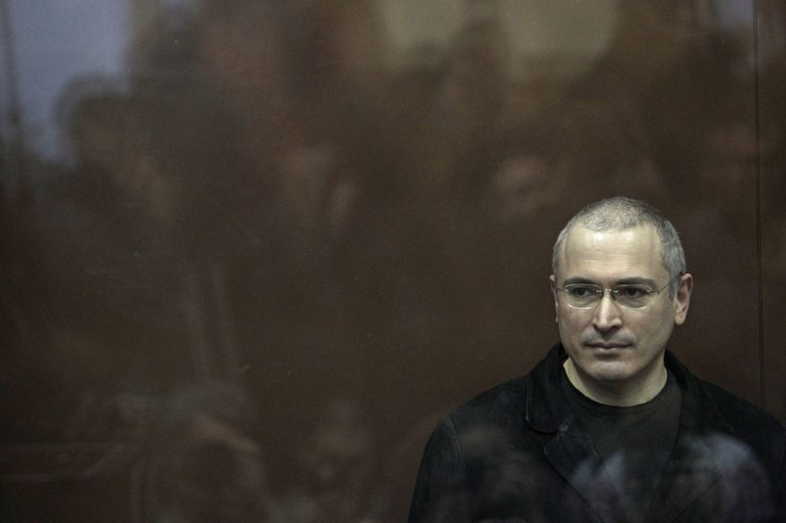Mikhail Khodorkovsky stands behind bars in a courtroom in Moscow on Monday, Dec. 27, 2010, where a Russian judge convicted him on theft and money-laundering charges. (AP Photo/Sergey Ponomarev)