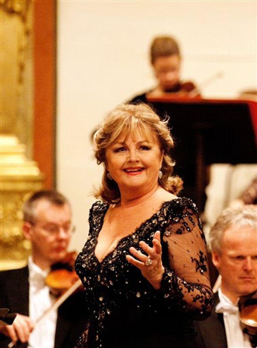 """In this photo taken Oct. 11, 2010, Soprano Edita Gruberova speaks during an interview with The Associated Press in Vienna, Austria. At the dizzying heights of her stellar operatic career, Gruberova has unexpectedly chosen to stoop and return to the role of the fallen woman who helped make her fame. Gruberova is not portraying just any wayward female. By rediscovering Violetta Valery of Verdi's """"La Traviata"""" (The Fallen Woman) at age 62, the Queen of Coloratura is in some ways retracing her first steps on the stairway to stardom. (AP Photo/Ronald Zak)"""