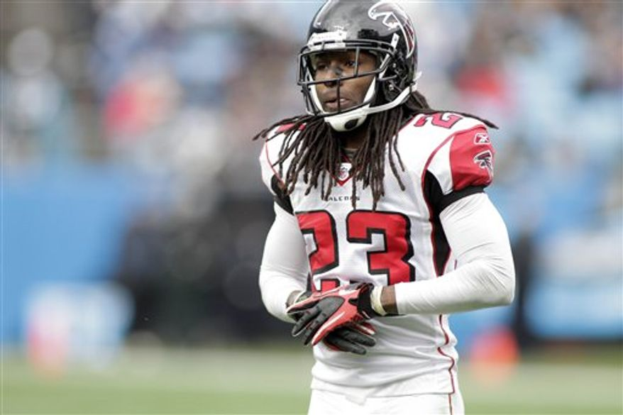 FILE - This Dec. 12, 2010, file photo shows Atlanta Falcons cornerback Dunta Robinson (23) during the first half of an NFL football game against the Carolina Panthers, in Charlotte, N.C.  Robinson is still looking for his first interception in Atlanta eight months after signing a contract with $22 million in guarantees.  (AP Photo/Rick Havner, File)