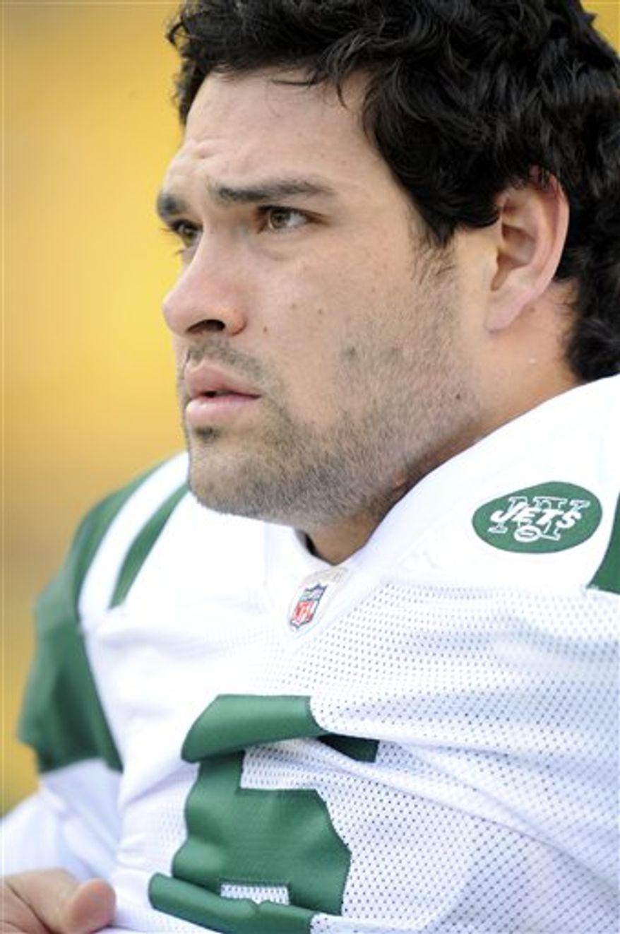 FILE - In this file photo taken Dec. 19, 2010, New York Jets quarterback Mark Sanchez throws a pass against the Pittsburgh Steelers during an NFL football game in Pittsburgh. The second-year quarterback was listed as probable on New York's injury report Friday, Dec. 24, 2010, and coach Rex Ryan fully expects Sanchez to be under center, barring a late setback, to start in the team's game at Chicago on Sunday, Dec. 26 after being limited with a sore right shoulder. (AP Photo/Tom E. Puskar, File)