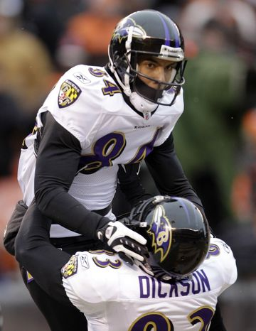 Baltimore Ravens wide receiver T.J. Houshmandzadeh, top, celebrates his 15-yard touchdown catch against the Cleveland Browns with tight end Ed Dickson in the second quarter of an NFL football game Sunday, Dec. 26, 2010, in Cleveland. (AP Photo/Tony Dejak)