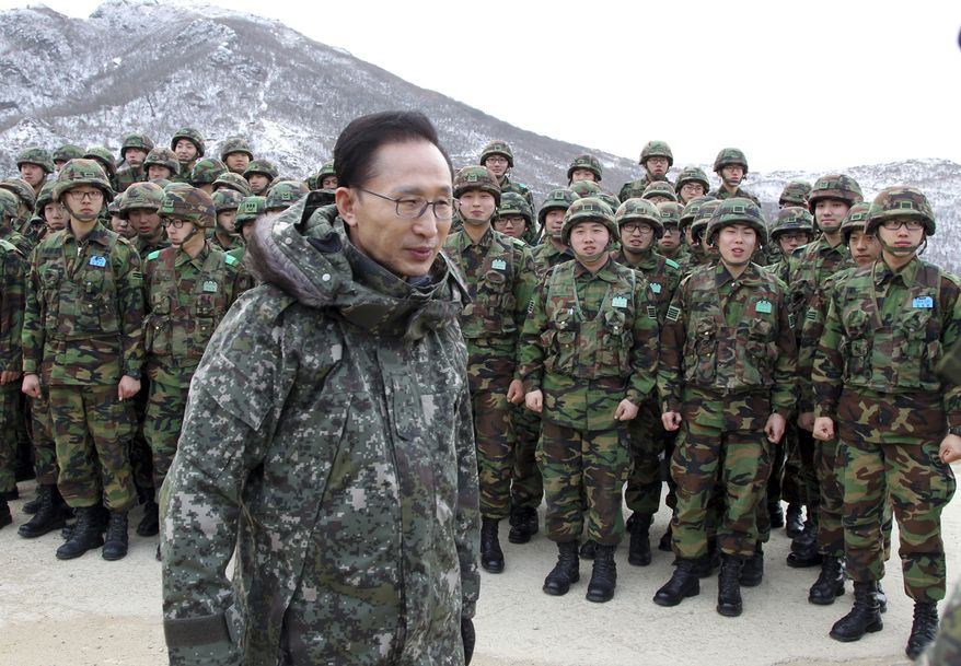 South Korean President Lee Myung-bak visits the South Korean Army soldiers at a military base near the demilitarized zone (DMZ) that separates the two Koreas since the Korean War, in Yanggu, north of Seoul, South Korea, Thursday, Dec. 23, 2010. South Korean fighter jets dropped bombs and tanks fired artillery Thursday as the military staged its largest air and ground firing drills of the year in a show of force a month after North Korea's deadly shelling of a front-line island. (AP Photo/ Jo Bo-hee, Yonhap)