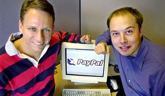 FILE - In this Oct. 20, 2000 file photo, PayPal Chief Executive Officer Peter Thiel, left, and founder Elon Musk, right, pose with the PayPal logo at corporate headquarters in Palo Alto, Calif. Thiel who who co-founded PayPal and gave Facebook its first big investment now wants Silicon Valley to buy into a bigger idea: the future. Thiel is backing groups that see a future when computers will communicate directly with the human brain. Seafaring pioneers will found new floating nations in the middle of the ocean. Science will conquer aging, and death will become a curable disease. (AP Photo/Paul Sakuma, File)