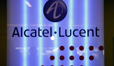 Paris-based Alcatel-Lucent SA has agreed to pay more than $137 million to settle charges brought against it by the Securities and Exchange Commission and the Department of Justice.(AP Photo/Francois Mori, file)