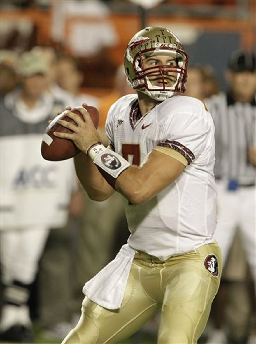 This Oct. 9, 2010 shows Florida State quarterback Christian Ponder (7) standing back to pass during an NCAA college football game against Miami in Miami. Florida State coach Jimbo Fisher says  Ponder is back as the team's starting quarterback for the Chick-fil-A Bowl against South Carolina. (AP Photo/Lynne Sladky)