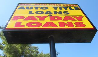 The federal Consumer Financial Protection Bureau is trying to adopt a new rule that could put 70 percent of payday lenders out of business. (AP Photo/Ryan J. Foley)