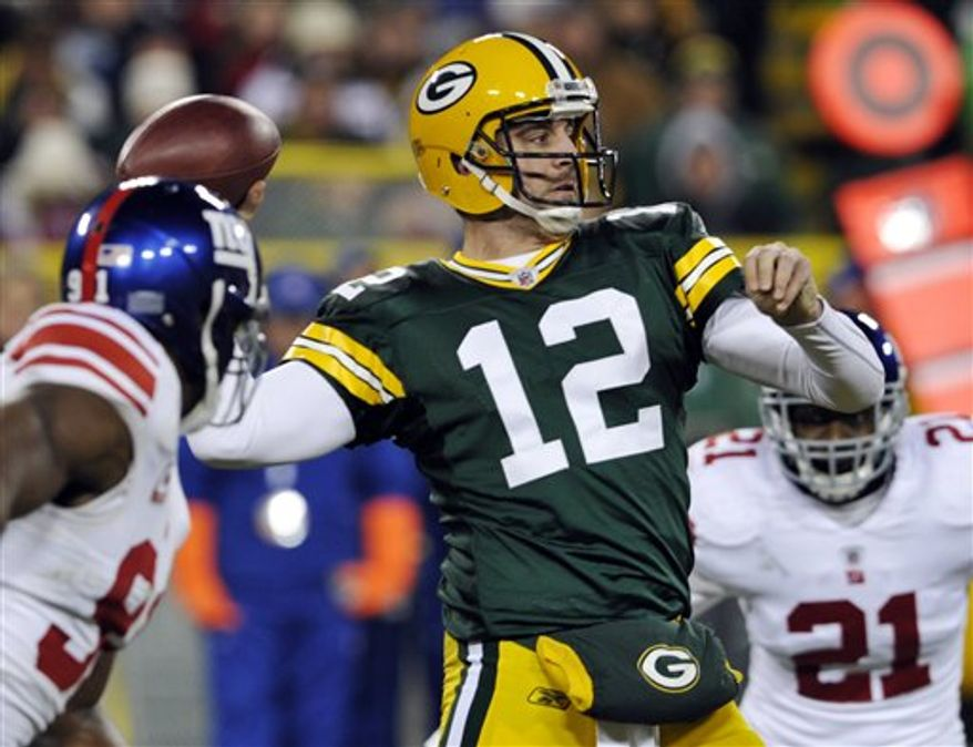 Green Bay Packers quarterback Aaron Rodgers throws during the second half of an NFL football game against the New York Giants on Sunday, Dec. 26, 2010, in Green Bay, Wis. The Packers won 45-17. (AP Photo/Jim Prisching)