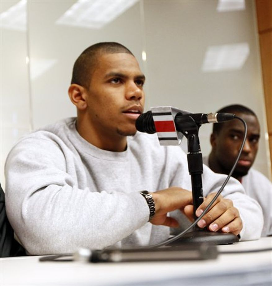 Ohio State football players, DeVier Posey, left, Mike Adams, Boom Herron, Terrelle Pryor during a news conference Tuesday, Dec. 28, 2010, in Columbus, Ohio. Ohio The Buckeye players were suspended by the NCAA for the first five games of next season for selling championship rings, jerseys and awards, and receiving improper benefits from a tattoo parlor. All can still play in the Sugar Bowl against Arkansas. (AP Photo/Terry Gilliam)