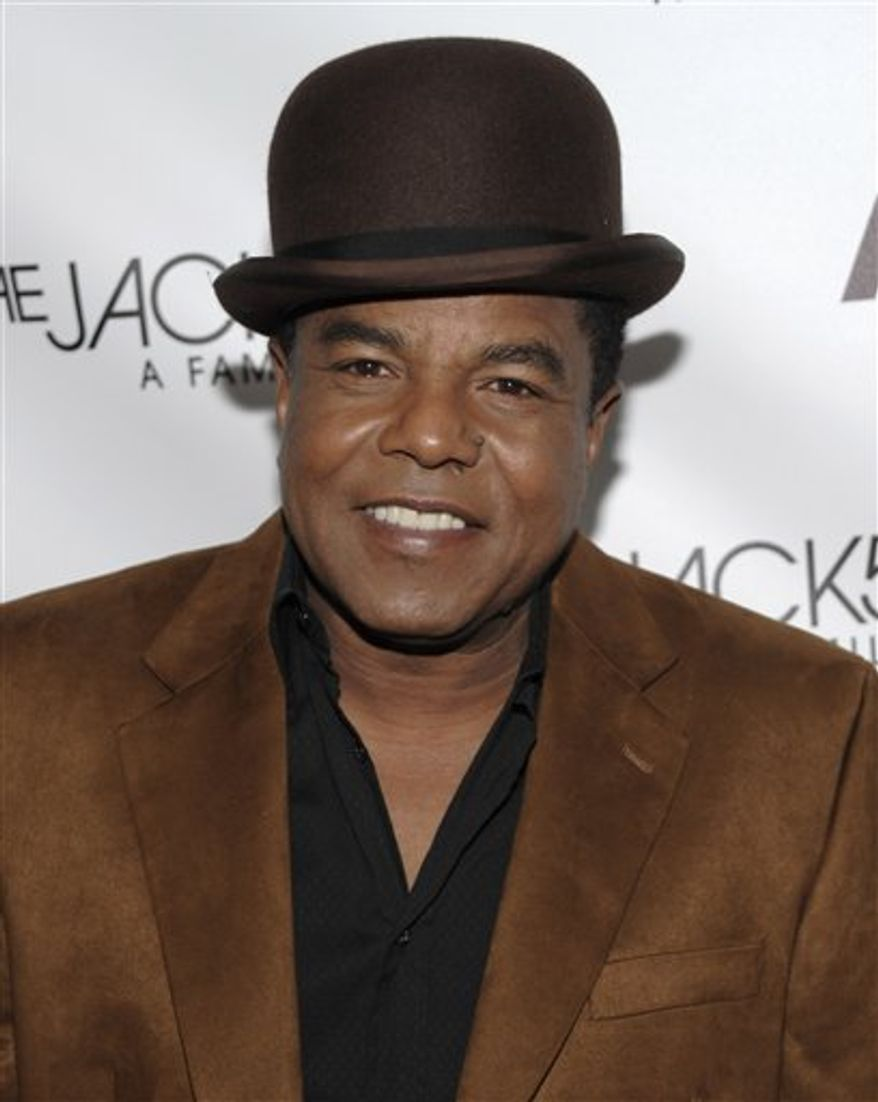"""FILE - In a Dec. 9, 2009 file photo, singer Tito Jackson arrives at the launch party for """"The Jacksons: A Family Dynasty"""" reality show debuting on A&E Network. Jackson is going solo.  The 57-year-old musician and original member of the Jackson 5 says he will unveil some of his new material during a New Year's Eve performance in Atlanta. He also plans to perform some Jackson 5 classics at the city's 22nd Annual Peach Drop celebration. Jackson's debut solo album, """"So Far, So Good,"""" will be released in early 2011. (AP Photo/Dan Steinberg, File)"""