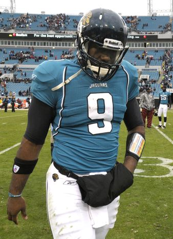 Jacksonville Jaguars quarterback David Garrard leaves the field Sunday after a 20-17 home loss in overtime against the Washington Redskins. (Associated Press)