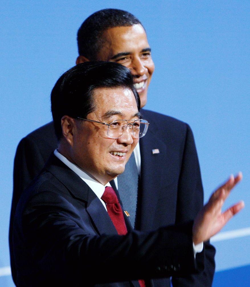 **FILE** President Obama welcomes Chinese President Hu Jintao as he arrives for a Group of 20 summit dinner in Pittsburgh in September 2009. (Associated Press)