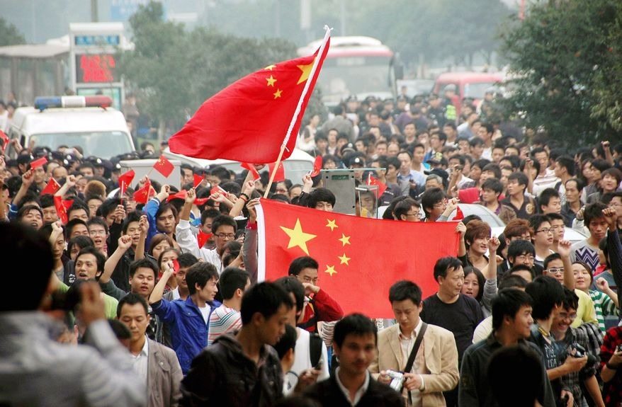 Anti-Japan protesters march in Wuhan, China, on Oct. 18. Beijing-Tokyo relations soured over the detention of a Chinese fishing boat captain accused of ramming two Japanese patrol boats in September near a string of islands in the East China Sea claimed by both countries. (Associated Press)