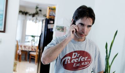 Pierre Werner answers a phone call Dec. 9 at his mother's home in Las Vegas concerning his business license, which was revoked. Mr. Werner's medical marijuana referral business was shut down by authorities. (Associated Press)