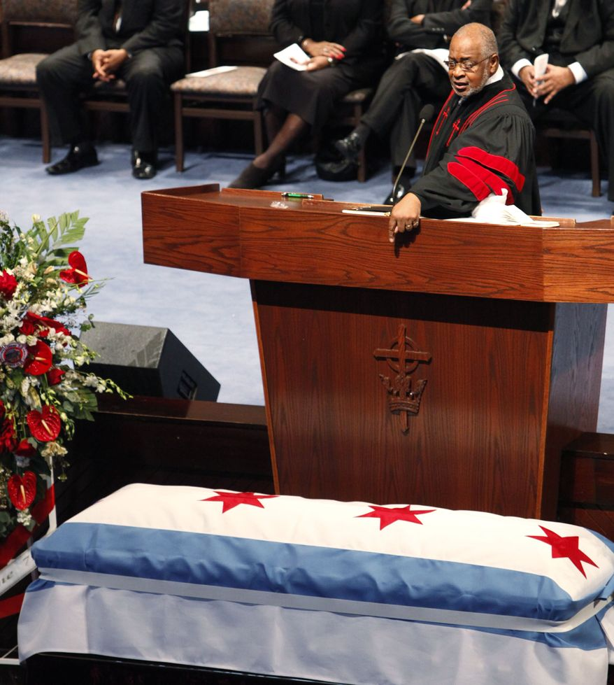 Rev. Dr. Louis D. Jones eulogizes Chicago firefighter Corey Ankum during Dec. 30 funeral services in Chicago. Ankum was one of two firefighters killed last week when a roof collapsed after a fire. (Associated Press)
