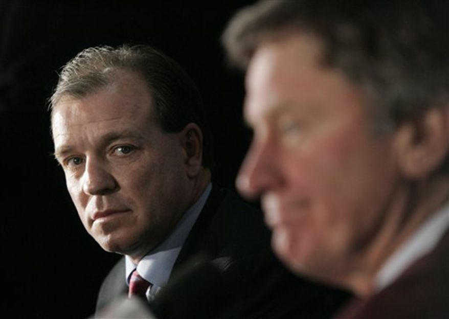 Florida State head coach Jimbo Fisher, left, listens to South Carolina head coach Steve Spurrier during a press conference for the Chick-fil-A Bowl Thursday, Dec. 30, 2010, at the Georgia Dome in Atlanta. The teams will face off in the game formerly known as the Peach Bowl tomorrow Dec. 31, also at the Georgia Dome. (AP Photo/John Amis)