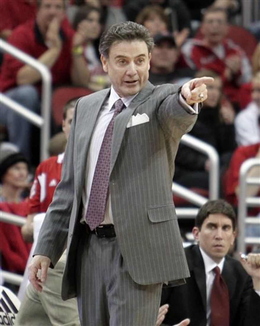Louisville coach Rick Pitino directs his team against Morgan State in their NCAA college basketball game in Louisville, Ky., Monday, Dec. 27, 2010. No. 22 Louisville rolled to a 104-74 victory. (AP Photo/Garry Jones)