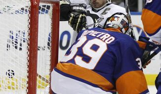 New York Islanders goalie Rick DiPietro (39) watches from the crease as Pittsburgh Penguins center Sidney Crosby (87) sends the puck into the wrong side of the net in the first period of the Islanders' 2-1 victory Wednesday at Nassau Coliseum in Uniondale, N.Y. (Associated Press)