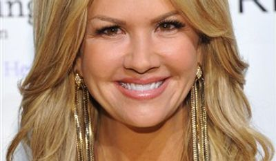 FILE - This Monday, Oct. 18, 2010 file picture shows Nancy O'Dell at the Ninth Annual Elton John AIDS Foundation benefit 'An Enduring Vision' in New York. (AP Photo/Evan Agostini)