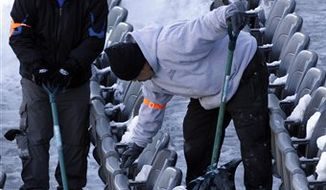 FILE - In this Dec. 27, 2010, file photo, work crews remove snow from the stands of Lincoln Financial Field, home of the Philadelphia Eagles NFL football team, in Philadelphia. With all that snow blocking roads, closing airports and forcing folks to stay home earlier this week, it's easy to wonder how the NFL and the Big Apple would handle a blizzard in February 2014. (AP Photo/Matt Rourke, File)