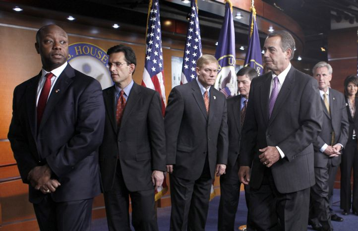 Rep.-elect, Tim Scott, R-S.C., left, leads following a Republican news conference on Capitol Hill in Washington on Nov. 18, 2010. From left are Scott, House Minority Whip Eric Cantor, Rep. Pete Sessions, R-Texas, Rep. Jeb Hensarling, R-Texas, House Speaker-in-waiting John Boehner of Ohio, Rep. Kevin McCarthy, R-Calif., and Rep.-elect Kristi Noem, R-S.D. (AP Photo/Harry Hamburg)