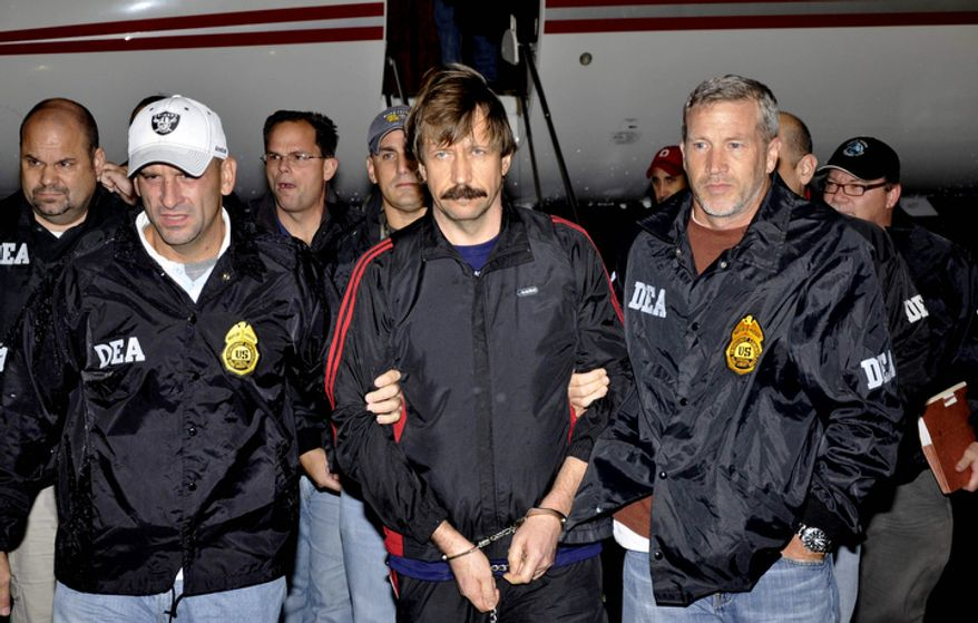 Russian arms trafficking suspect Viktor Bout, center, is in U.S. custody after being flown from Bangkok to New York in a chartered U.S. plane, extradited in manacles to face terrorism charges despite a final outraged push by Russian diplomats to persuade Thailand to release him on Nov. 16, 2010. (AP Photo/Drug Enforcement Administration, File)