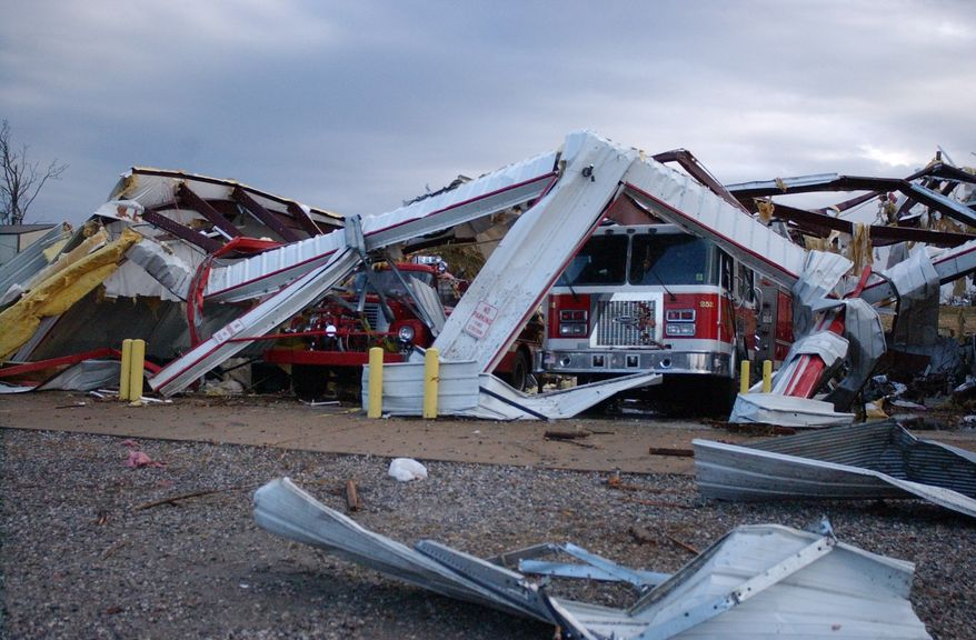 The station for the Cincinnati, Ark., volunteer fire department was destroyed shortly after 6 a.m. Friday, Dec. 31, 2010, when an apparent tornado swept across the rural, unincorporated community that's west of Fayetteville, Ark. Three people died when a nearby home and barn were destroyed by the storm. (AP Photo/Washington County Enterprise-Leader, Northwest Arkansas Times, Rod Russell)
