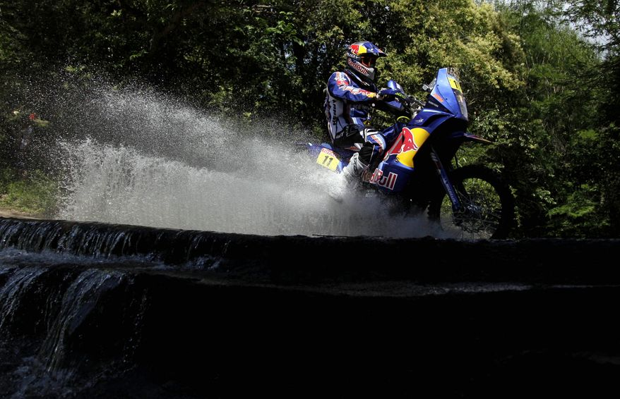 Portugal's Ruben Faria rides his KTM motorcycle Sunday during the first stage of the 2011 Argentina-Chile Dakar Rally between Victoria and Cordoba, Argentina. (Associated Press)