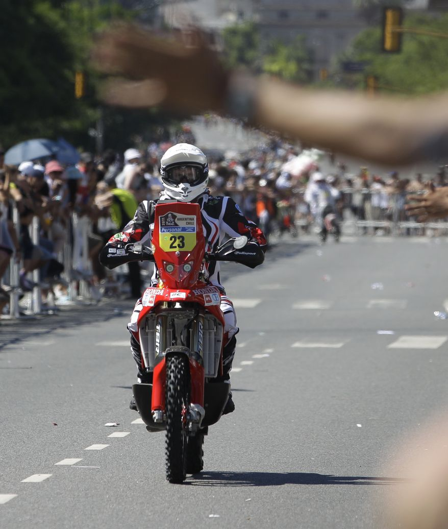 France's Cyril Esquirol rides his Honda Saturday during the Argentina-Chile Dakar Rally 2011 symbolic start in Buenos Aires, Argentina. Esquirol fell from his motorcycle Sunday near the first stage in Victoria, Argentina, and was immediately taken by helicopter to a hospital. (Associated Press)