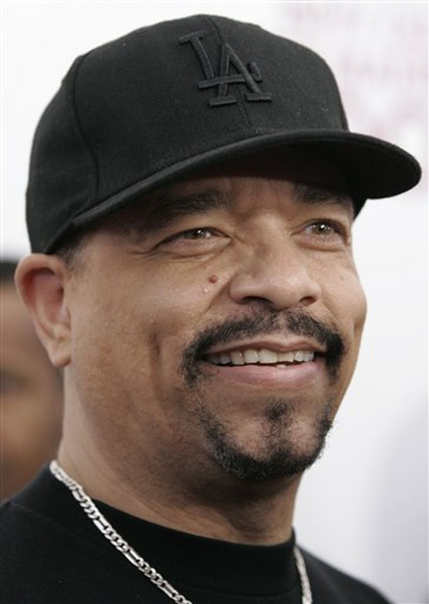 "FILE - In this file photo, Ice-T arrives for the Special Screening of Tyler Perry's 'Why Did I Get Married Too?', Monday, March 22, 2010 in New York. Hungary's media authority says it is investigating a radio station for playing Ice-T songs with explicit lyrics, an announcement that got an enthusiastic response from the hip-hop star and actor. The Ice-T songs ""Warning"" and ""It's On"" played in September of last year should have been broadcast only after 9 p.m., the National Media and Infocommications Authority said in a statement posted on its Web site Saturday. (AP Photo/Jessica Rinaldi, File)"