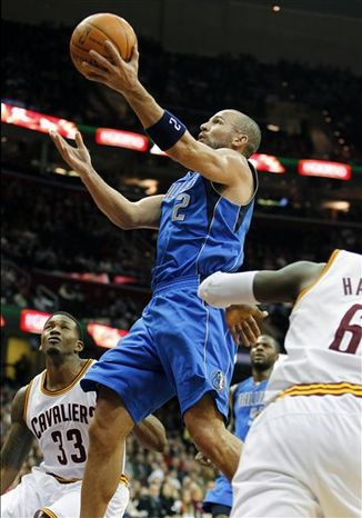 Cleveland Cavaliers' Alonzo Gee, right, grabs a rebound against Dallas Mavericks' Brendan Haywood in the first quarter during an NBA basketball game Sunday Jan. 2, 2011, in Cleveland. (AP Photo/Ron Schwane)