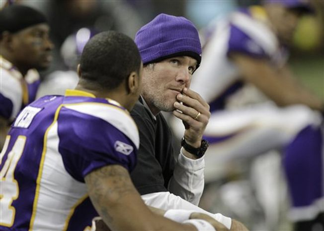 FILE - In this Dec. 13, 2010 file photo, Minnesota Vikings quarterback Brett Favre watches from the sidelines against the New York Giants in the first half of their NFL football game at Ford Field in Detroit. (AP Photo/Paul Sancya, File)