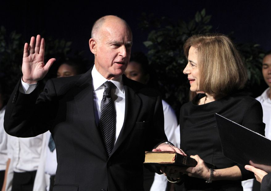 Jerry Brown is sworn in as the 39th governor of California as his wife, Anne Gust Brown, holds a family Bible during ceremonies in Sacramento, Calif., on Monday, Jan. 3, 2011. (AP Photo/Rich Pedroncelli)