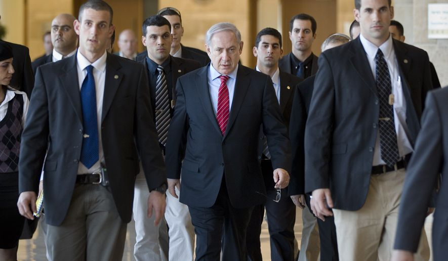 Israeli Prime Minister Benjamin Netanyahu (center), surrounded by bodyguards, arrives at a Foreign Affairs and Security Committee meeting in the Knesset, Israel's parliament, in Jerusalem on Monday, Jan. 3, 2011. (AP Photos/Bernat Armangue)