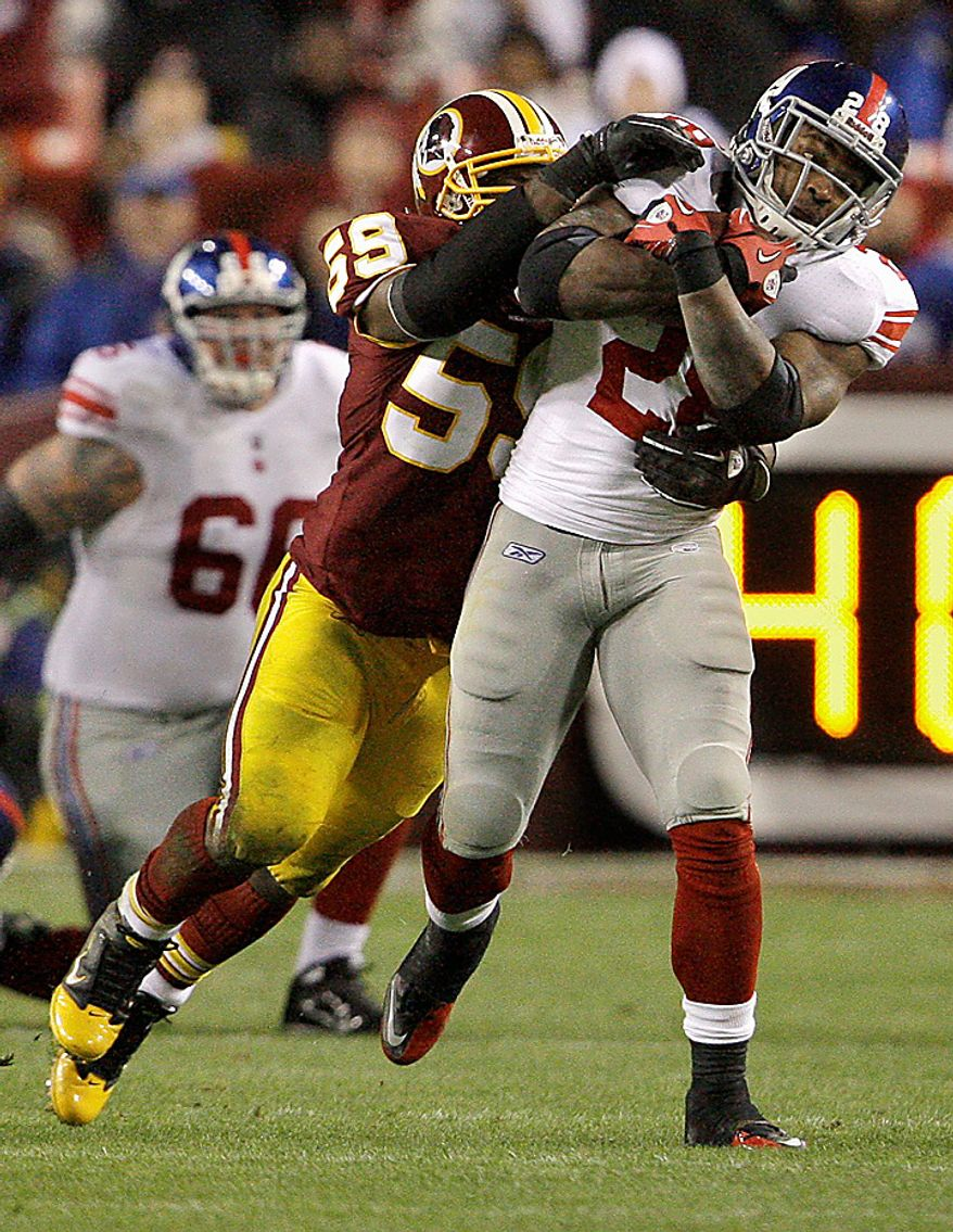 Washington Redskins linebacker London Fletcher (59) tackles New York Giants running back Danny Ware (28)  during the first half of an NFL football game in Landover, Md., on Sunday, Jan. 2, 2011. (AP Photo/Jacquelyn Martin)