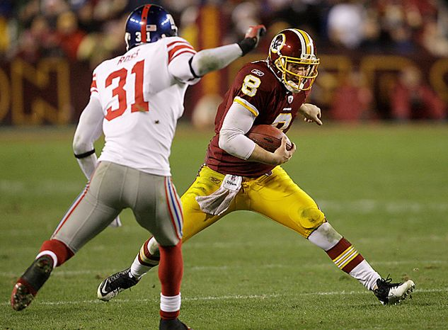 ** FILE ** Washington Redskins quarterback Rex Grossman (8) evades New York Giants cornerback Aaron Ross (31) during the second half of an NFL football game in Landover, Md., on Sunday, Jan. 2, 2011. The Giants won, 17-14. (AP Photo/Jacquelyn Martin)
