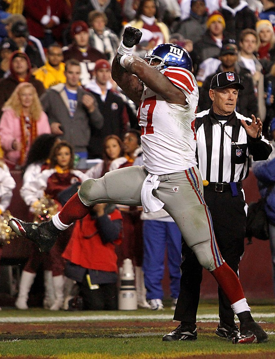 New York Giants running back Brandon Jacobs (27) celebrates after scoring a touchdown against the Washington Redskins during the first half of an NFL football game in Landover, Md., on Sunday, Jan. 2, 2011. (AP Photo/Jacquelyn Martin)
