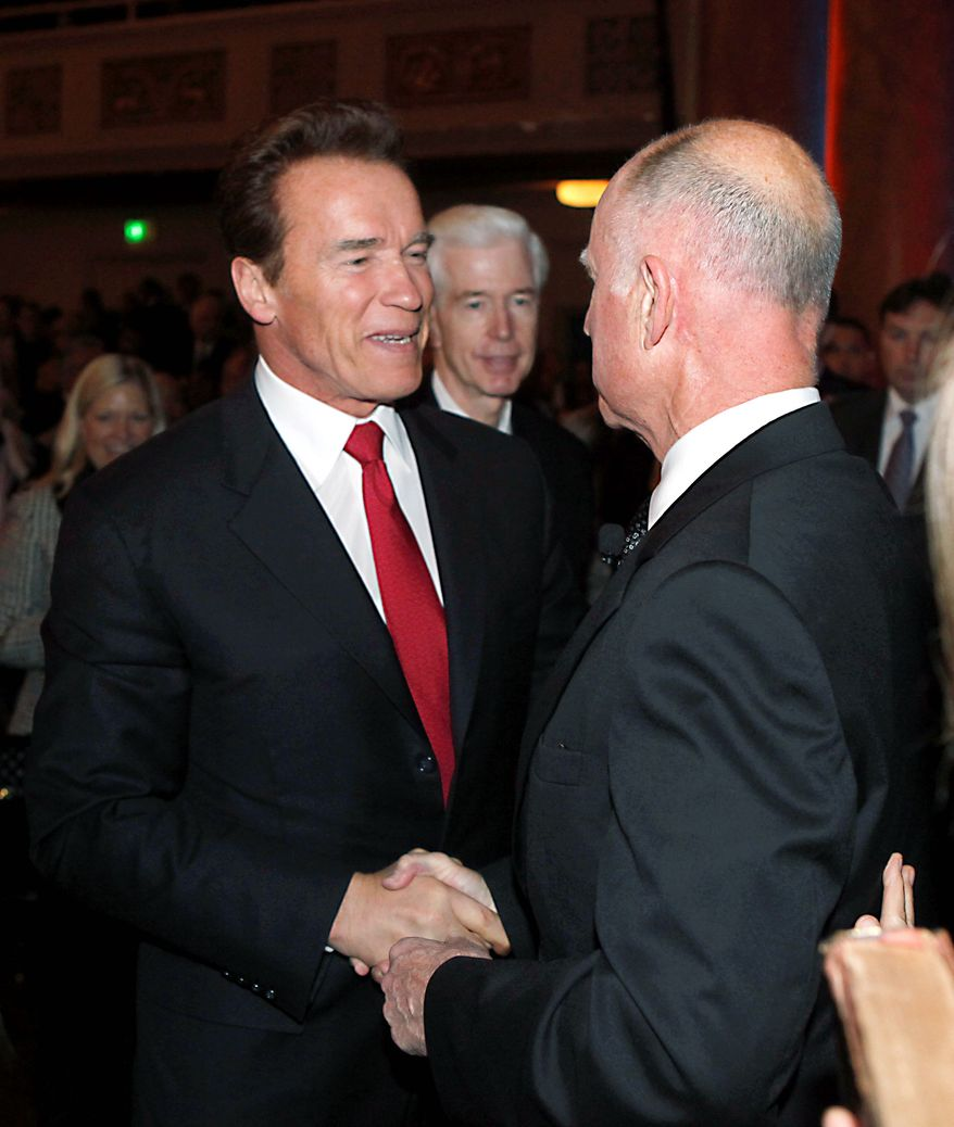 Outgoing California Gov. Arnold Schwarzenegger (left) congratulates his successor, Jerry Brown, after Mr. Brown was sworn in in Sacramento, Calif., on Monday. Former Gov. Gray Davis, who preceded Mr. Schwarzenegger, looks on. (Associated Press)