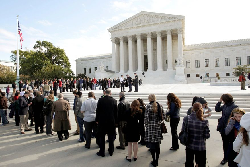 People wait in line in front of the Supreme Court. Sweeping marble staircases, sculptures, manicured gardens and ornate doors beckoned citizens of the past. Now most stand empty and sealed, a forbidden welcome. (Associated Press)