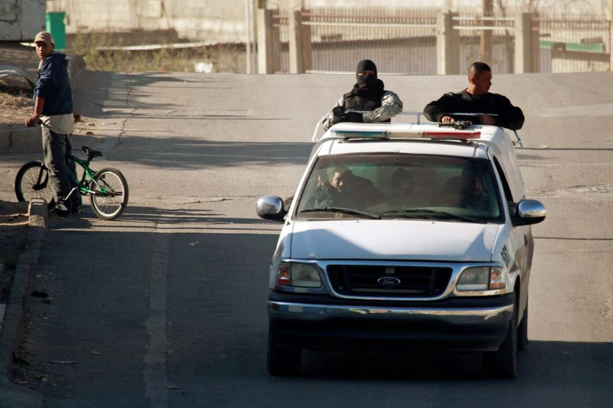 Police patrol the streets of Ciudad Juarez, Mexico, across the border from El Paso, Texas, in December. More than 3,000 people were killed there in 2010, and mayhem spread by drug cartels has caused residents to flee and businesses to close. (Associated Press)