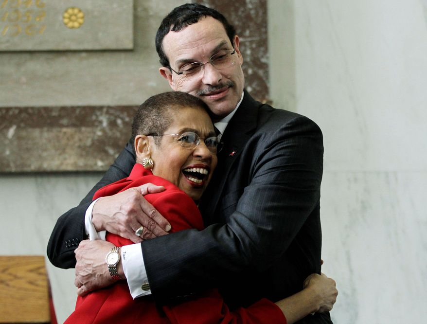 D.C. Mayor Vincent C. Gray embraces congressional Delegate Eleanor Holmes Norton, his fellow D.C. Democrat, at a news conference on D.C. congressional voting rights Tuesday on Capitol Hill. (Associated Press)