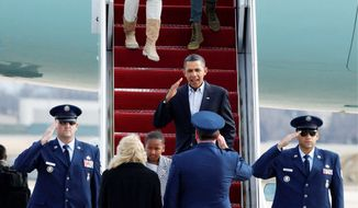 President Obama returns a salute as he and daughter Sasha arrive with his wife, Michelle, and other daughter Malia at Andrews Air Force Base in Maryland on Tuesday after nearly two weeks of vacation in Hawaii. (Associated Press)