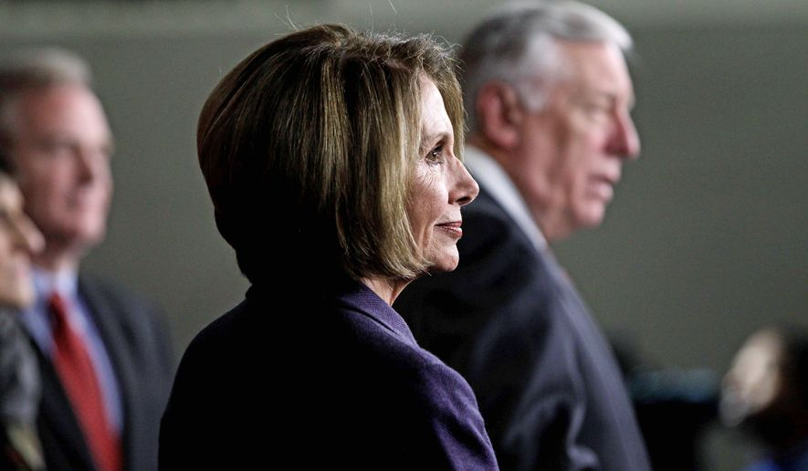 NEW MINORITY: Outgoing House Speaker Nancy Pelosi of California and outgoing House Majority Leader Steny H. Hoyer of Maryland prepare Tuesday for changes on Capitol Hill. (Associated Press)