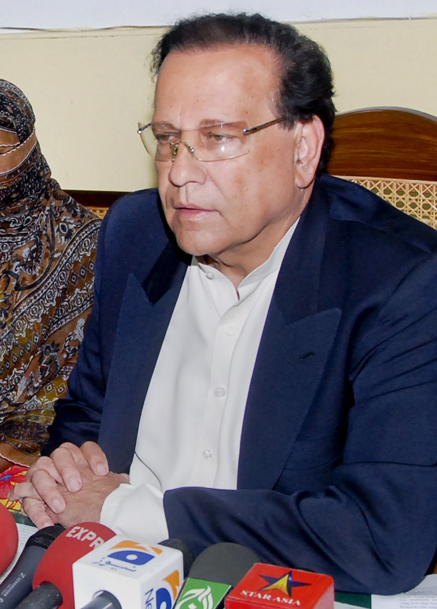 ** FILE ** In this Nov. 20, 2010, file photo, Salman Taseer, governor of Pakistani Punjab Province, talks to reporters after meeting with Pakistani Christian woman Asia Bibi, not in photo, at a prison in Sheikhupura near Lahore, Pakistan. Taseer was shot dead Tuesday, Jan. 4, 2011, by one of his guards in the Pakistani capital, apparently because he had spoken out against the country's controversial blasphemy laws, officials said. (AP Photo/File)