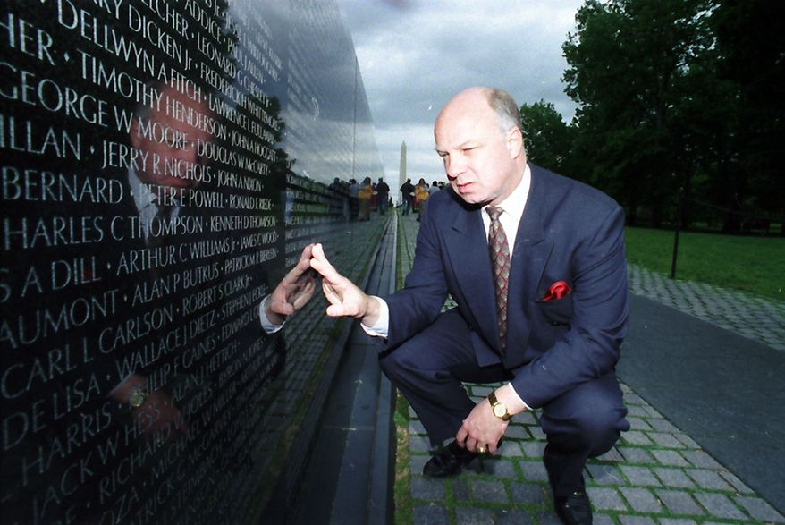 ** FILE ** In this May 17, 1994 file photo, John Wheeler III touches the name of a friend engraved in the Vietnam Veterans Memorial in Washington. Wheeler's body was discovered on Dec. 31, 2010, at the Wilmington, Del.-area landfill. His death has been ruled a homicide. (AP Photo/Charles Tasnadi, File)