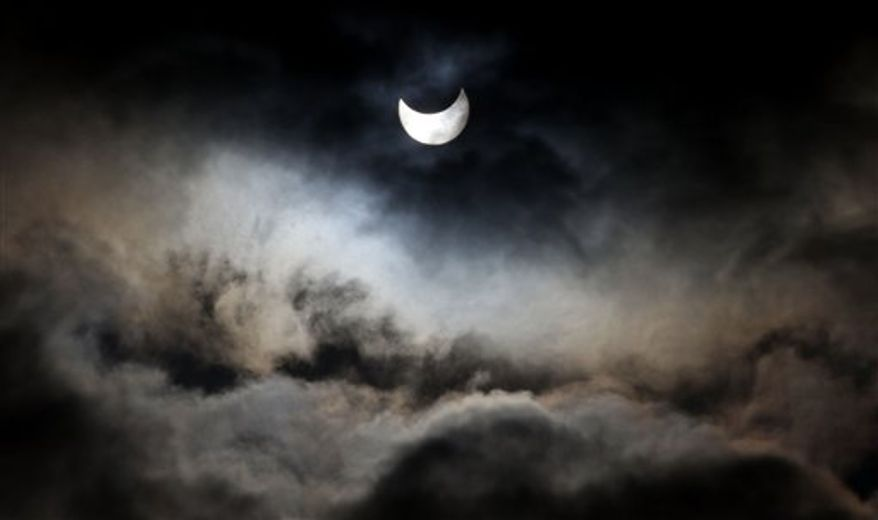 A view of a partial solar eclipse as seen from Gaza city Tuesday, Jan. 4, 2011. A partial solar eclipse began Tuesday in the skies over the Mideast and extended across much of Europe. (AP Photo/Hatem Moussa)