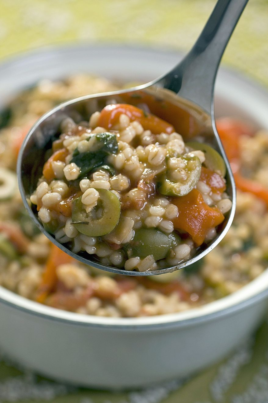 Mediterranean barley vegetable stew would appeal to vegans. Vegan food is a celebration of produce, as is this stew. (Associated Press)